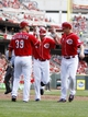Aug 4, 2013; Cincinnati, OH, USA; Cincinnati Reds shortstop Zack Cozart (2) is congratulated by catcher Devin Mesoraco (39) and right fielder Jay Bruce (32) after hitting a home run during the second inning against the St. Louis Cardinals at Great American Ball Park. Mandatory Credit: Frank Victores-USA TODAY Sports