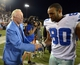 iAug 4, 2013; Canton, OH, USA; Dallas Cowboys owner Jerry Jones (left) shakes hands with tight end Dante Rosario (80) after the 2013 Hall of Fame Game against the Miami Dolphins at Fawcett Stadium. The Cowboys defeated the Dolphins 24-20. Mandatory Credit: Kirby Lee-USA TODAY Sports