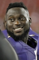 Aug 8, 2013; Tampa, FL, USA; Baltimore Ravens safety Matt Elam (26) on the sidelines smiles during the second half against the Tampa Bay Buccaneers at Raymond James Stadium. Mandatory Credit: Kim Klement-USA TODAY Sports
