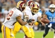 Aug 8, 2013; Nashville, TN, USA; Washington Redskins quarterback Pat White (5) pitches the ball to Redskins running back Evan Royster (22) in a game against the Tennessee Titans during the second half at LP Field. The Redskins beat the Titans 22-21. Mandatory Credit: Don McPeak-USA TODAY Sports