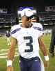 Aug 8, 2013; San Diego, CA, USA; Seattle Seahawks quarterback Russell Wilson (3) after a win against the San Diego Chargers at Qualcomm Stadium. The Seahawks won 31-10. Mandatory Credit: Christopher Hanewinckel-USA TODAY Sports