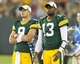 Aug 9, 2013; Green Bay, WI, USA; Green Bay Packers quarterbacks B.J. Coleman (9) and  Vince Young (13) look on during the fourth quarter against the Arizona Cardinals at Lambeau Field.  The Cardinals won 17-0.  Mandatory Credit: Jeff Hanisch-USA TODAY Sports