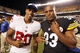 Aug 10, 2013; Pittsburgh, PA, USA; New York Giants wide receiver Victor Cruz (80) and Pittsburgh Steelers running back Isaac Redman (33) pose for a photo after their game at Heinz Field. The New York Giants won 18-13. Mandatory Credit: Charles LeClaire-USA TODAY Sports