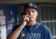 Aug 11, 2013; Los Angeles, CA, USA;    Tampa Bay Rays pitching coach Jim Hickey (48) makes a call to the bullpen during the game against the Los Angeles Dodgers at Dodger Stadium. Mandatory Credit: Jayne Kamin-Oncea-USA TODAY Sports