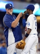 Aug 11, 2013; Los Angeles, CA, USA;   Los Angeles Dodgers shortstop Dee Gordon (9) gets high five from batting coach Mark McGwire (12) at the end of the game against the Tampa Bay Rays at Dodger Stadium. Dodgers won 8-2. Mandatory Credit: Jayne Kamin-Oncea-USA TODAY Sports