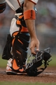 July 9, 2013; San Francisco, CA, USA; Detail view of San Francisco Giants catcher Guillermo Quiroz (12) picking up his face mask during the fourth inning against the New York Mets at AT&T Park. The Mets defeated the Giants 10-6. Mandatory Credit: Kyle Terada-USA TODAY Sports