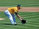Aug 15, 2013; Oakland, CA, USA; Oakland Athletics starting pitcher Sonny Gray (54) fields a ground ball against the Houston Astros during the third inning at O.Co Coliseum. Mandatory Credit: Ed Szczepanski-USA TODAY Sports
