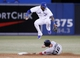 Aug 15, 2013; Toronto, Ontario, CAN; Boston Red Sox third baseman Will Middlebrooks (16) breaks up the double play attempt from Toronto Blue Jays shortstop Jose Reyes (7) during the fourth inning at the Rogers Centre. Mandatory Credit: John E. Sokolowski-USA TODAY Sports