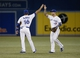 Aug 15, 2013; Toronto, Ontario, CAN; Toronto Blue Jays first baseman Mark DeRosa (16) and third baseman Brett Lawrie (13) celebrate a win over the Boston Red Sox at the Rogers Centre. Toronto defeated Boston 2-1. Mandatory Credit: John E. Sokolowski-USA TODAY Sports