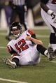 Aug 15, 2013; Baltimore, MD, USA; Atlanta Falcons quarterback Sean Renfree (12) after being sacked by the Baltimore Ravens defense at M&T Bank Stadium. Mandatory Credit: Mitch Stringer-USA TODAY Sports