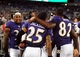 Aug 15, 2013; Baltimore, MD, USA; Baltimore Ravens cornerback Asa Jackson (25) is congratulated by wide receiver Torrey Smith (82) and running back Anthony Allen (35) after scoring on a 78 yard punt return in the fourth quarter against the Atlanta Falcons at M&T Bank Stadium. Mandatory Credit: Evan Habeeb-USA TODAY Sports