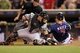 Aug 15, 2013; Minneapolis, MN, USA; Minnesota Twins catcher Joe Mauer (7) slides safely into home plate before Chicago White Sox catcher Josh Phegley (36) can make the tag in the eighth inning at Target Field. The Twins won 4-3. Mandatory Credit: Jesse Johnson-USA TODAY Sports