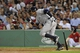 Aug 16, 2013; Boston, MA, USA; New York Yankees third baseman Alex Rodriguez (13) hits a single during the third inning against the Boston Red Sox at Fenway Park. Mandatory Credit: Bob DeChiara-USA TODAY Sports