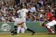 Aug 16, 2013; Boston, MA, USA; New York Yankees left fielder Alfonso Soriano (12) hits a three run home run during the third inning against the Boston Red Sox at Fenway Park. Mandatory Credit: Bob DeChiara-USA TODAY Sports