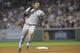 Aug 16, 2013; Boston, MA, USA; New York Yankees shortstop Eduardo Nunez (26) runs to third base after hitting a triple during the fourth inning against the Boston Red Sox at Fenway Park. Mandatory Credit: Bob DeChiara-USA TODAY Sports