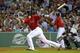 Aug 16, 2013; Boston, MA, USA; Boston Red Sox catcher Jarrod Saltalamacchia (39) hits an RBI single during the seventh inning against the New York Yankees at Fenway Park. Mandatory Credit: Bob DeChiara-USA TODAY Sports