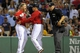 Aug 16, 2013; Boston, MA, USA; Boston Red Sox pinch hitter Mike Carp (37) argues a call while being restrained by third base coach Brian Butterfield (13) during the seventh inning against the New York Yankees at Fenway Park. Mandatory Credit: Bob DeChiara-USA TODAY Sports