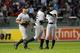 Aug 16, 2013; Boston, MA, USA; New York Yankees center fielder Brett Gardner (left) left fielder Alfonso Soriano (12) and right fielder Ichiro Suzuki (31) celebrate their victory over the Boston Red Sox at Fenway Park. Mandatory Credit: Bob DeChiara-USA TODAY Sports