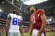 August 17, 2013; Phoenix, AZ, USA; Arizona Cardinals wide receiver Larry Fitzgerald (11) speaks with Dallas Cowboys wide receiver Dez Bryant (88) following the 12-7 victory at University of Phoenix Stadium. Mandatory Credit: Gary A. Vasquez-USA TODAY Sports