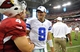 August 17, 2013; Phoenix, AZ, USA; Dallas Cowboys quarterback Tony Romo (9) meets with Arizona Cardinals kicker Jay Feely (4) following the 12-7 loss at University of Phoenix Stadium. Mandatory Credit: Gary A. Vasquez-USA TODAY Sports