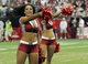 Aug 17, 2013; Phoenix, AZ, USA; Arizona Cardinals cheerleaders perform during the second half against the Dallas Cowboys at University of Phoenix Stadium. The Cardinals defeated the Cowboys 12-7. Mandatory Credit: Casey Sapio-USA TODAY Sports