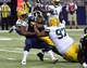 Aug 17, 2013; St. Louis, MO, USA; Green Bay Packers linebacker Andy Mulumba (46) and Packers defensive tackle Johnny Jolly (97) tackle St. Louis Rams running back Benny Cunningham (45) for a 2 yard loss during the first half at the Edward Jones Dome. Mandatory Credit: Scott Rovak-USA TODAY Sports