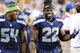 Aug 17, 2013; Seattle, WA, USA; Seattle Seahawks middle linebacker Bobby Wagner (54) and running back Robert Turbin (22) talk during the 2nd half against the Denver Broncos at CenturyLink Field. Seattle defeated Denver 40-10. Mandatory Credit: Steven Bisig-USA TODAY Sports