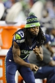Aug 17, 2013; Seattle, WA, USA; Seattle Seahawks cornerback Richard Sherman (25) jokes around on the sidelines during the 2nd half against the Denver Broncos at CenturyLink Field. Seattle defeated Denver 40-10. Mandatory Credit: Steven Bisig-USA TODAY Sports