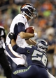 Aug 17, 2013; Seattle, WA, USA; Denver Broncos quarterback Brock Osweiler (17) is sacked by Seattle Seahawks linebacker Ty Powell (58) during the fourth quarter at CenturyLink Field. Mandatory Credit: Joe Nicholson-USA TODAY Sports