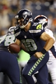 Aug 17, 2013; Seattle, WA, USA; Seattle Seahawks quarterback Brady Quinn (10) hands off the ball against the Denver Broncos during the second half at CenturyLink Field. Mandatory Credit: Joe Nicholson-USA TODAY Sports