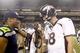 Aug 17, 2013; Seattle, WA, USA; Seattle Seahawks quarterback Russell Wilson (3) and Denver Broncos quarterback Peyton Manning (18) speak following a 40-10 preseason victory by the Seahawks at CenturyLink Field. Mandatory Credit: Joe Nicholson-USA TODAY Sports