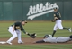 Aug 19, 2013; Oakland, CA, USA; Oakland Athletics shortstop Jed Lowrie (8) tags out Seattle Mariners shortstop Brad Miller (5) at second base during the first inning at O.Co Coliseum. Mandatory Credit: Ed Szczepanski-USA TODAY Sports