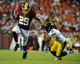 Aug 19, 2013; Landover, MD, USA; Washington Redskins running back Roy Helu avoids the tackle of Pittsburgh Steelers defensive back Ross Ventrone (41) during the second half at FedEX Field. Mandatory Credit: Brad Mills-USA TODAY Sports