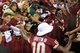 Aug 19, 2013; Landover, MD, USA; Washington Redskins quarterback Robert Griffin III (10) shakes hands with fans after the Redskins game against the Pittsburgh Steelers at FedEx Field. The Redskins won 24-13. Mandatory Credit: Geoff Burke-USA TODAY Sports