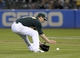 Aug 19, 2013; Oakland, CA, USA; Oakland Athletics starting pitcher Jarrod Parker (11) fields a ground ball during the eighth inning against the Seattle Mariners at O.Co Coliseum. The Oakland Athletics defeated the Seattle Mariners 2-1. Mandatory Credit: Ed Szczepanski-USA TODAY Sports