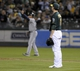 Aug 19, 2013; Oakland, CA, USA; Oakland Athletics starting pitcher Jarrod Parker (11) reacts after committing and error during the eighth inning of the game against the Seattle Mariners at O.Co Coliseum. The Oakland Athletics defeated the Seattle Mariners 2-1. Mandatory Credit: Ed Szczepanski-USA TODAY Sports