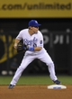 Aug 20, 2013; Kansas City, MO, USA; Kansas City Royals second baseman Chris Getz (17) turns a double play in the seventh inning against the Chicago White Sox at Kauffman Stadium. Mandatory Credit: John Rieger-USA TODAY Sports
