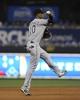 Aug 20, 2013; Kansas City, MO, USA; Chicago White Sox shortstop Alexei Ramirez (10) throws to first against the Kansas City Royals in the eighth inning at Kauffman Stadium. Chicago won the game 2-0. Mandatory Credit: John Rieger-USA TODAY Sports