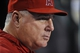 August 20, 2013; Anaheim, CA, USA; Los Angeles Angels manager Mike Scioscia (14) watches game action during the fifth inning against the Cleveland Indians at Angel Stadium of Anaheim. Mandatory Credit: Gary A. Vasquez-USA TODAY Sports