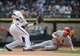 Aug 21, 2013; Milwaukee, WI, USA; St. Louis Cardinals center fielder Shane Robinson (right) steals 2nd base as Milwaukee Brewers second baseman Scooter Gennett waits for the ball in the 5th inning at Miller Park. Mandatory Credit: Benny Sieu-USA TODAY Sports