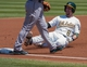 Aug 21, 2013; Oakland, CA, USA; Oakland Athletics shortstop Jed Lowrie (8) slides into third base after hitting a triple during the first inning against the Seattle Mariners at O.Co Coliseum. Mandatory Credit: Ed Szczepanski-USA TODAY Sports