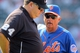 Aug 21, 2013; New York, NY, USA; New York Mets manager Terry Collins (10) argues a call with first base umpire Jerry Layne (24) after Atlanta Braves first baseman Freddie Freeman (not pictured) hit an infield single against the New York Mets during the tenth inning of a game at Citi Field. Mandatory Credit: Brad Penner-USA TODAY Sports