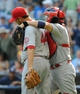 Aug 21, 2013; Milwaukee, WI, USA;  St. Louis Cardinals catcher Yadier Molina (right) gives pitcher Edward Mujica (left) a hug after Mujica got the save as the Cardinals beat the Milwaukee Brewers 8-6 at Miller Park. Mandatory Credit: Benny Sieu-USA TODAY Sports
