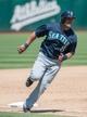 Aug 21, 2013; Oakland, CA, USA; Seattle Mariners designated hitter Kendrys Morales (8) rounds third base against the Oakland Athletics during the sixth inning at O.Co Coliseum. Mandatory Credit: Ed Szczepanski-USA TODAY Sports