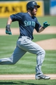 Aug 21, 2013; Oakland, CA, USA; Seattle Mariners second baseman Dustin Ackley (13) runs to home plate on his way to score against the Oakland Athletics during the sixth inning at O.Co Coliseum. Mandatory Credit: Ed Szczepanski-USA TODAY Sports