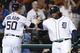 Aug 21, 2013; Detroit, MI, USA; Detroit Tigers catcher Bryan Holaday (50) receives congratulations from first baseman Prince Fielder (28) after scoring in the seventh inning against the Minnesota Twins at Comerica Park. Mandatory Credit: Rick Osentoski-USA TODAY Sports