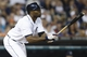 Aug 21, 2013; Detroit, MI, USA; Detroit Tigers right fielder Torii Hunter (48) hits an two RBI double in the seventh inning against the Minnesota Twins at Comerica Park. Mandatory Credit: Rick Osentoski-USA TODAY Sports