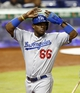 Aug 21, 2013; Miami, FL, USA;  Los Angeles Dodgers right fielder Yasiel Puig (66) reacts after scoring on a  double by shortstop Hanley Ramirez (not pictured) in the fourth inning against  at Marlins Park. Mandatory Credit: Robert Mayer-USA TODAY Sports