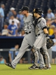 Aug 21, 2013; Kansas City, MO, USA; Chicago White Sox relief pitcher Addison Reed (43) is congratulated by catcher Josh Phegley (36) after the game against the Kansas City Royals at Kauffman Stadium. Chicago won 5-2. Mandatory Credit: Denny Medley-USA TODAY Sports