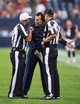 Aug 17, 2013; Houston, TX, USA; Houston Texans head coach Gary Kubiak argues a call with umpire Steve Wilson (29) and head linesman Kent Payne (79) during the game between the Texans and the Miami Dolphins at Reliant Stadium. The Texans defeated the Dolphins 24-17. Mandatory Credit: Jerome Miron-USA TODAY Sports